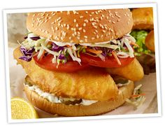 CRISPY ARCTIC COD SANDWICH-  Rock the burger boat with this deliciously fresh and crispy aquatic alternative featuring shredded cabbage, tomatoes, pickles and tartar sauce.
