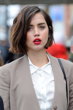 Ana de Armas beige and buttoned with mussed hear and bright lips