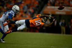 Description of . Emmanuel Sanders (10) of the Denver Broncos misses a pass in the fourth quarter. The Denver Broncos played the Indianapolis Colts at Sports Authority Field at Mile High in Denver, Colo. on September 7, 2014. (Photo by AAron Ontiveroz/The Denver Post)  -- #ProFootballDenverBroncos