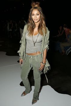 Nicole Scherzinger pairs cargo pants with stilettos at the Greg Lauren NYFW show...