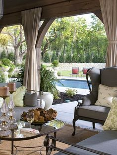 Poolside Patio, love coziness of outdoor drapes and privacy of stone wall