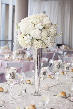 Ivory wedding centerpiece | Wedding Planner: The Graceful Host | Flowers: New Creation Flower Company | Venue: Mint Museum Uptown | Charlotte NC