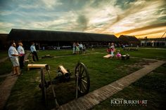 The sunsets over a game of cornhole, during a wedding reception at Old Fort Jackson. www.photosbyrb.com