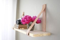Easy DIY shelf & other lovely ideas | At Home in Love......love the shelf idea, making it out of leather straps and a board, the camera and the flowers are right up my alley