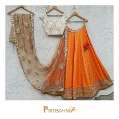 A chic summer wedding look.Look radiant in this orange and offwhite lehenga set on your Sangeet and Mehendi day For more information write to info@ . Indian Bridal Lehenga, Indian Bridal Wear, Indian Wedding Outfits, Indian Outfits, Indian Sarees, Indian Wear, Half Saree Lehenga, Lehnga Dress, Anarkali