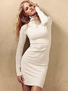 """Part sweater. Part dress. Totally sexy. This wardrobe wonder is your answer to those nothing-to-wear days. Cable-knit sleeves and supersoft cotton make it a three-season staple. The turtleneck and slim fit give it a timelessly chic silhouette.  Turtleneck  Cable-knitsleeves  Can also be worn as a tunic  21"""" from waist  Machine wash. Tumble dry.  Imported cotton"""
