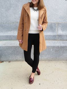 Ivory knit sweater, black Pixie pants, red loafers, camel coat
