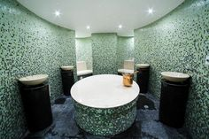 Calm, luxurious and radiant with light, Dahlia SPA at Four Seasons Hotel Abu Dhabi. - Dahlia SPA del Four Seasons di Abu Dhabi, rilassante, lussuosa e luminosa. Mosaic Glass, Mosaic Tiles, Mosaics, Custom Glass, Four Seasons Hotel, Sink, Bathtub, Shades, Abu Dhabi