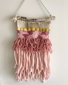A personal favourite from my Etsy shop https://www.etsy.com/au/listing/485961639/rustric-pink-wall-hanging-weaving