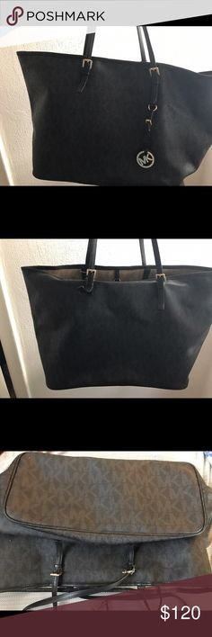 MK Black Monogram Tote Bag MK leather bag and leather handles with canvas on the inside. It's been well-loved! But the leather is still good and the bag is clean and still has a lot of life. Bought for 300, a little firm on the price. But taking offers! Michael Kors Bags Totes