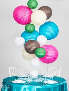 Paper lanterns make gorgeous centerpiece decor! Here's how to create a Paper Lantern Chandelier. | Smarty Had A Party