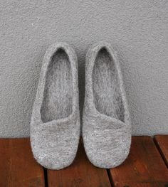 Handmade felted slippers, $67.00 on Etsy.  Love the slant element!