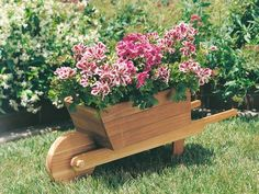 Add a wheelbarrow planter to your garden and create an old-fashioned look to your backyard and home. Wheelbarrow Planter, Chair Planter, Planter Boxes, Planters, Planter Ideas, Outdoor Projects, Wood Projects, Plant Decor, Yard Art