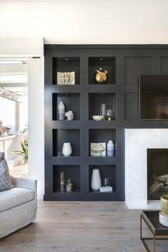 modern built ins around modern fireplace, dark gray builts in in modern meets traditional living room decor, neutral modern living room design, Jet Black Built-in Bookcase Jet Black Built-in Bookcase Bookcase Cabinetry Paint Grade with square detail Built In Wall Shelves, Built In Bookcase, Office Bookshelves, Organizing Bookshelves, Black Bookcase, Wall Shelving, Bookshelf Design, Corner Shelves, Bookcases
