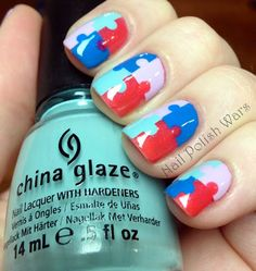 Puzzle piece nails! this would be great for autism puzzle pieces are their symbol I dont think I could do it free hand though.  My son and daughter have autism.