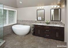Contemporary Master Bathroom with Complex granite counters, frameless showerdoor, Freestanding Bathtub, English Grey Mosaic