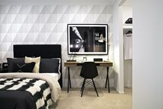 Clarendon Homes.  Portview 33.  Contrasting white textured feature wall in a secondary bedroom.