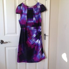 BEBE dress! Fun colors and will make you look super good! I love this dress but after wearing it a couple times I wanted it to go to another home! Just dry cleaned bebe Dresses