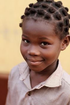 Girl in Lomé, Togo by Dietmar Temps, via Flickr
