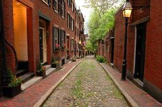 Acorn Street on Beacon Hill, note street made of river stones. Tradesmen lived in these houses. One of the most photographed streets in America.