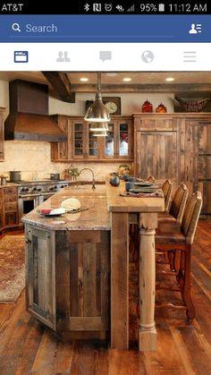 Love the kitchen decor and island/bar