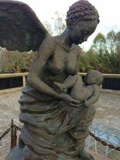 Rod Moorehead's bronze statue of a black angel carrying a slave child to heaven…