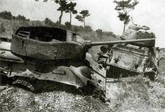 Two T-34 lie destroyed. The vehicle has lost nearest the top of the turret due to an internal explosion...