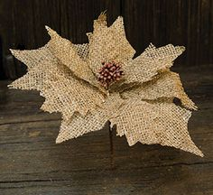 Lightly frayed and deep natural burlap petals surround a beaded floral center, set on a brown-wrapped wired stem. The flower is in diameter and the stem is long. Burlap Projects, Burlap Crafts, Burlap Wreath, Christmas Booth, Christmas Crafts, Christmas Decorations, Burlap Christmas Ornaments, Burlap Flowers, Fabric Flowers