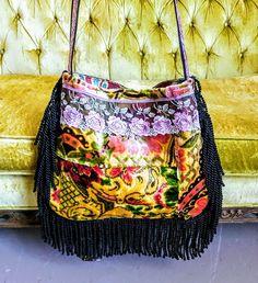 Reserve Vintage velvet boho bag with fringe.