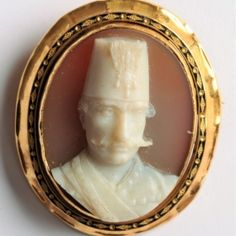 High relief hardstone cameo brooch with the portrait of Nassiruddin Shah of Iran in white on grey background.  Multiple dents on the frame, but an extremely rare cameo.  It can be remounted if required.  38 x 45mm  www.Osprey.fr   €2200 Paris, Gray Background, Iran, Vintage Jewelry, Portrait, Antiques, Jewerly, Antiquities, Montmartre Paris