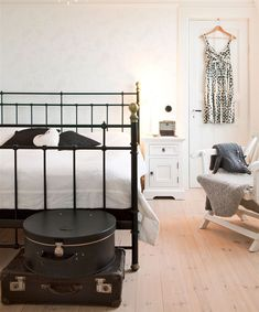 Cool Rustic Scandinavian House In Black And White. We have a black bed, and white nightstands. I love the hanger, and the white bedding.