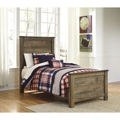 Built with form and function in mind, this Signature Design by Ashley original Trinell Twin-size bed frame is a sturdy, strong and fully functional bedroom accent piece.