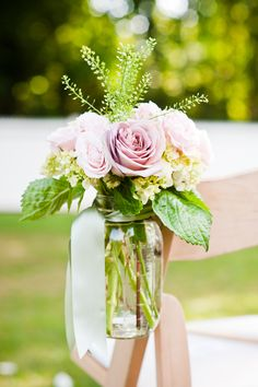 Mason jar florals for chair decor | Photography: W Studios New York - www.wstudiosnewyork.com  Read More: http://www.stylemepretty.com/tri-state-weddings/2014/04/24/vintage-bedell-cellars-vineyard-wedding/