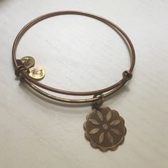 Alex and Ani Flower Star of Venus Alex and Ani Star of Venus charm worn and SOME TARNISH as seen in photosPRICE DROP 👇🏻👇🏻👇🏻 Alex & Ani Jewelry Bracelets