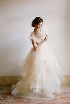 The way this dress appears to be made of gossamer and air. |