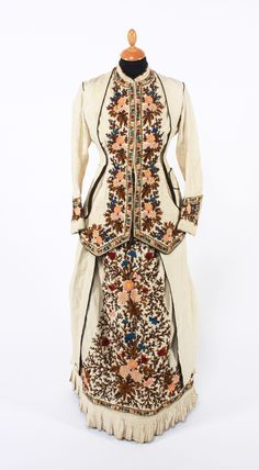 An 1880s embroidered day dress.  WOW that is really unique!