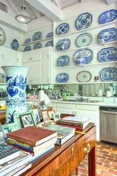 """Furlow Gatewood's amazing kitchen featuring an amazing collection of blue and white platters. Love it because the room is not """"done."""""""