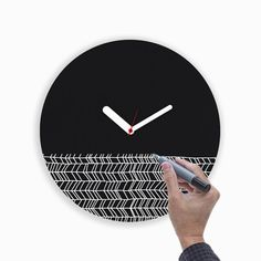 "Draw Up Wall Clock $33.99 Product Details — Includes Marker  — Uses AA Batteries; Not Included  MaterialsPvc Measurements14.1""L x 14.1""W x 2""H OriginItaly"