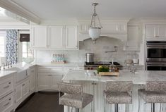 marble backsplash + countertops in classic white kitchen by Tiffany Eastman Interiors