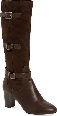 BELLA VITA Women's Shoes in Brown Suede Color. Adjustable belts cinch the velvety-soft shaft of a knee-high bootie lifted by a stacked-block heel and outfitted with a cushioned footbed.