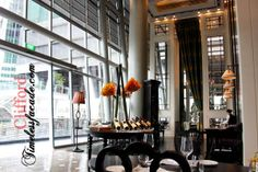 Semi-private table settings by the windows, and the private dining room at the far end behind the towering drapes-LRC