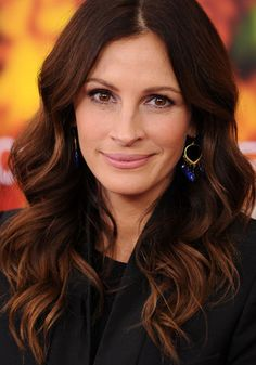 I think Julia Roberts looks lovely here. Dark brown hair with ombre tips with a nude lipstick.