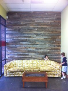 Wall of reclaimed lumber. Lobby of The ReWork Project in Austin, TX where homeless friends create beautiful upcycled furniture for retail sale.