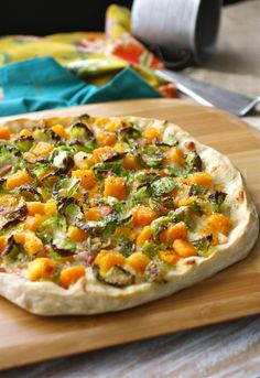 Try a seasonal pizza! Brussels Sprouts, Butternut Squash, and Pancetta Pizza.