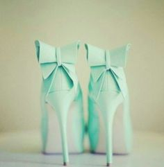 Mint heels with bows on the back. So cute