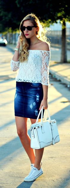 Gorgeous denim shorts with top white lace off the shoulder and white leather hand bag and white soft shoes and black goggles the best street fashion inspiration & cute looks
