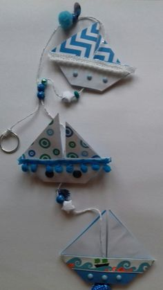 Blue origami boats hanging decoration by red acer paper