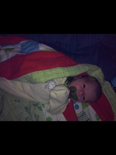 Baby in my rag quilt I made.