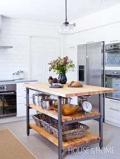 This hardwearing butcherblock island boasts plenty of open storage space, perfect for keeping everyday items out of the way but within arm's reach