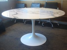 Knoll Saarinen White Dining Table with 54 Inch Round Marble  Top | From a unique collection of antique and modern dining room tables at https://www.1stdibs.com/furniture/tables/dining-room-tables/